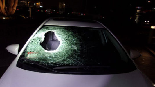 Boulder thrown from overpass kills young man in car with his family
