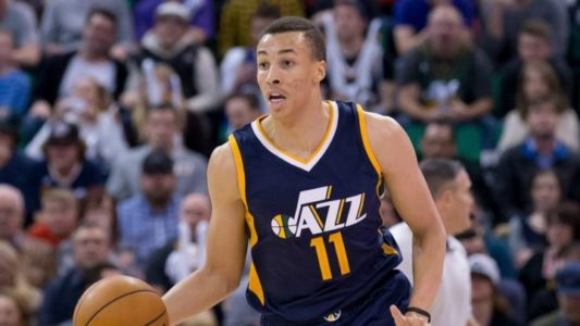 The Latest: Dante Exum stays in Utah for 3 years