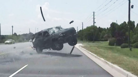 Dashcam video shows wild police chase end with car rolling and ejecting driver
