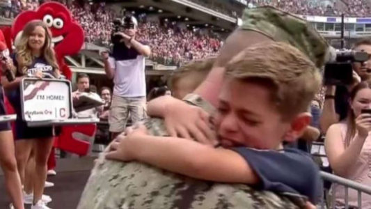 Boys reunite with dad at Cleveland Indians game after yearlong deployment at Guantanamo Bay