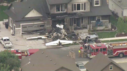The scene where a plane crashed into a home in Payson, Utah, on August 13, 2013.