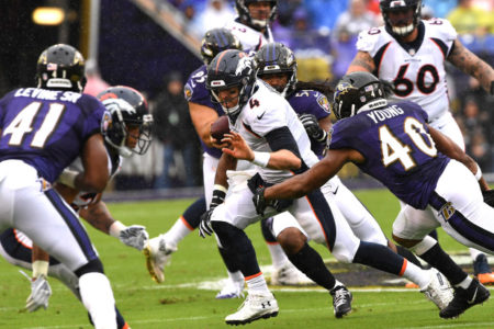 BALTIMORE, MD - SEPTEMBER 23: Denver Broncos quarterback Case Keenum #4 caught in the back field vs the Baltimore Ravens at M&T Bank Stadium on September 23, 2018 in Baltimore, MD. (Photo by Joe Amon/The Denver Post)