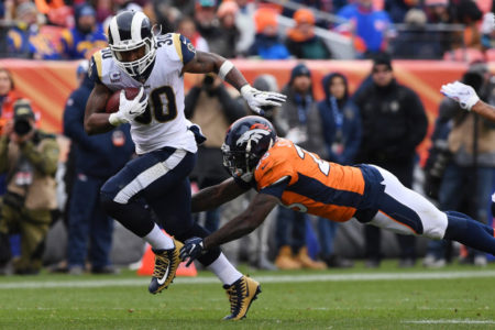 DENVER, CO - OCTOBER 14: Todd Gurley (30) of the Los Angeles Rams evades a tackle by Darian Stewart (26) of the Denver Broncos during the third quarter. The Denver Broncos hosted the Los Angelos Rams at Broncos Stadium at Mile High in Denver, Colorado on Sunday, October 14, 2018. (Photo by Joe Amon/The Denver Post)