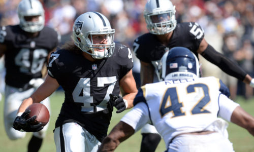 August 18, 2018; Los Angeles, CA, USA; Oakland Raiders linebacker James Cowser (47) runs the ball after an interception against the Los Angeles Rams during the second half at Los Angeles Memorial Coliseum. Mandatory Credit: Gary A. Vasquez-USA TODAY Sports