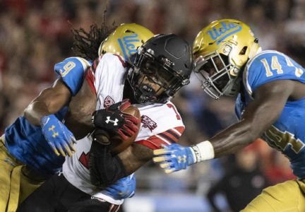 Utah wide receiver Demari Simpkins, center, tries to escape from UCLA defensive back Elijah Gates, left, and linebacker Krys Barnes during the first half of an NCAA college football game Friday, Oct. 26, 2018, in Pasadena, Calif. (AP Photo/Kyusung Gong) ORG XMIT: PRB101
