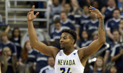 Feb 25, 2018; Reno, NV, USA; Nevada Wolf Pack forward Jordan Caroline (24) celebrates in the second half against the Colorado State Rams forward Nico Carvacho (32) at Lawlor Events Center. Mandatory Credit: Lance Iversen-USA TODAY Sports