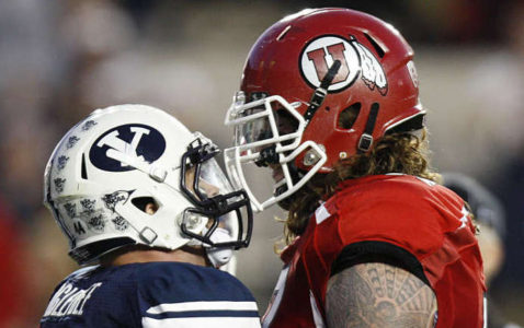 Brigham Young Cougars linebacker Brandon Ogletree (44) and Utah Utes offensive linesman John Cullen (77) get in each other's face as BYU and Utah play Saturday, Sept. 17, 2011