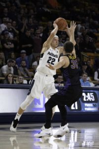 Passing to his point guard Brock Miller reaches over the Northern Iowa player Wednesday November 28, 2018. Utah State defeated Nothern Iowa 71-52.