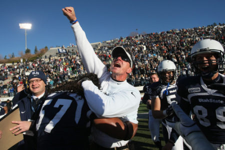 Chris Detrick  |  The Salt Lake Tribune Utah State head coach Gary Andersen celebrates with Utah State Aggies defensive lineman Havea Lasike (57) after winning the game at Romney Stadium Saturday November 26, 2011. Utah State defeated Nevada 21-17 and will be bowl-eligible for the first time since 1997.
