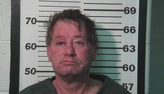 Police: Man shoves Christmas tree, fires gun at roommates
