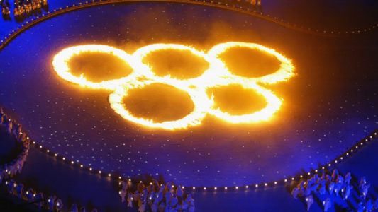 SALT LAKE CITY, UT - FEBRUARY 8:  The Olympic Rings in flames during the Opening Ceremony of the Salt Lake City Winter Olympic Games at the Rice-Eccles Olympic Stadium in Salt Lake City, Utah on February 8, 2002. (Photo by Donald Miralle/Getty Images)