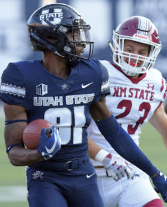 Utah State's Savon Scarver (81) returns a kickoff 100 yards for a touchdown as New Mexico State defensive back Ron LaForce (23) chases him during an NCAA college football game Saturday, Sept. 8, 2018, in Logan, Utah. (Eli Lucero/The Herald Journal via AP)
