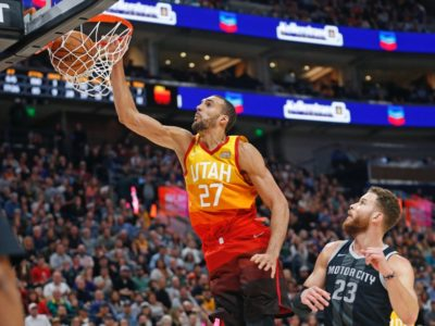 Utah Jazz center Rudy Gobert (27) dunks the ball as Detroit Pistons forward Blake Griffin (23) looks on during the second half of an NBA basketball game Monday, Jan. 14, 2019, in Salt Lake City. (AP Photo/Rick Bowmer)