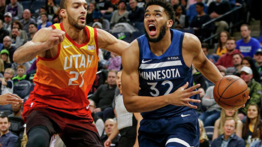 Jan 27, 2019; Minneapolis, MN, USA; Minnesota Timerwolves forward Karl-Anthony Towns (32) drives to the basket around Utah Jazz center Rudy Gobert (27) in the first quarter at Target Center. Mandatory Credit: Bruce Kluckhohn-USA TODAY Sports