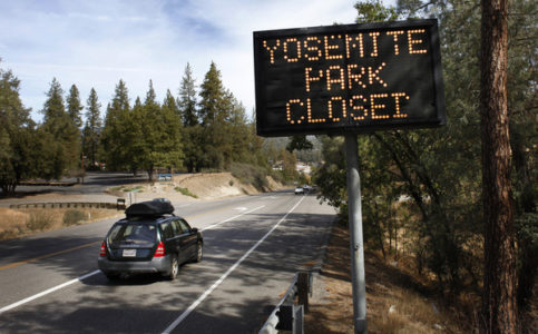 Sign on Rt. 41 in Oakhurst notifying travelers that Yosemite Park is closed Tuesday, Oct. 1, 2013. The shutdown of the federal government overnight meant that some federal employees, such as rangers who staff national parks, were furloughed as their positions are considered 'non-essential.' The shutdown means anyone who is in Yosemite National Park has 48 hours to leave if the House and Senate can't come to an agreement on a funding bill that puts the federal government back in business. (Patrick Tehan/Bay Area News Group)
