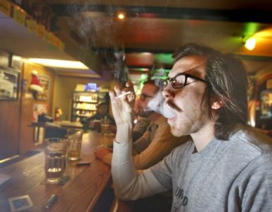 Sitting at the bar of Murphy's  at 160 So. Main Street in Salt Lake,  Finley Armstrong (front) and Steve Fugitt  take drags on what could be one of their last cigarettes  smoked  in a bar on  Friday, December 26, 2008.  A new law goes into effect on the first of January banning smoking in bars.Paul Fraughton / Salt Lake Tribune