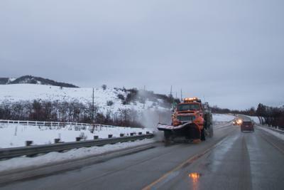 Utah snowfall slows traffic, closes schools