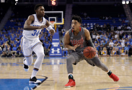 Utah guard Sedrick Barefield (2) dribbles next to UCLA guard David Singleton (34) during the first half of an NCAA college basketball game Saturday, Feb. 9, 2019, in Los Angeles. (AP Photo/Marcio Jose Sanchez)